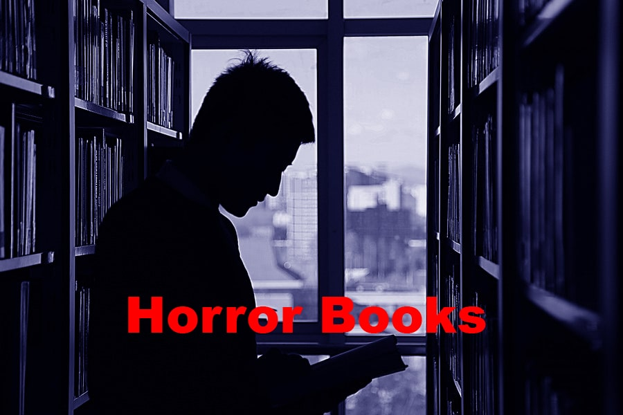 a man reading horror book