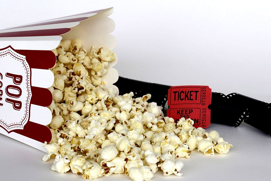 this image shows popcorn, movie ticket and show reel