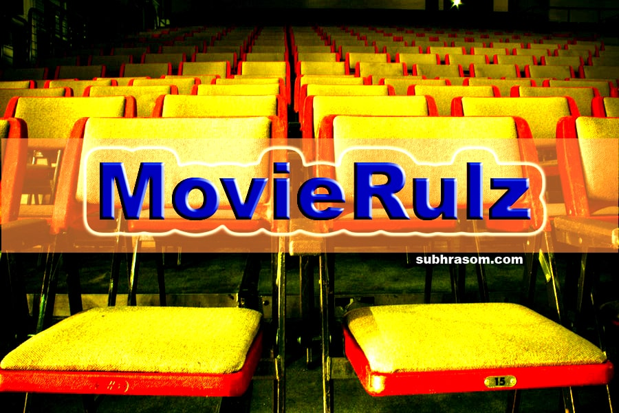"Movierulz article cover pic. Blue text written as :MovieRulz"" in the middle"