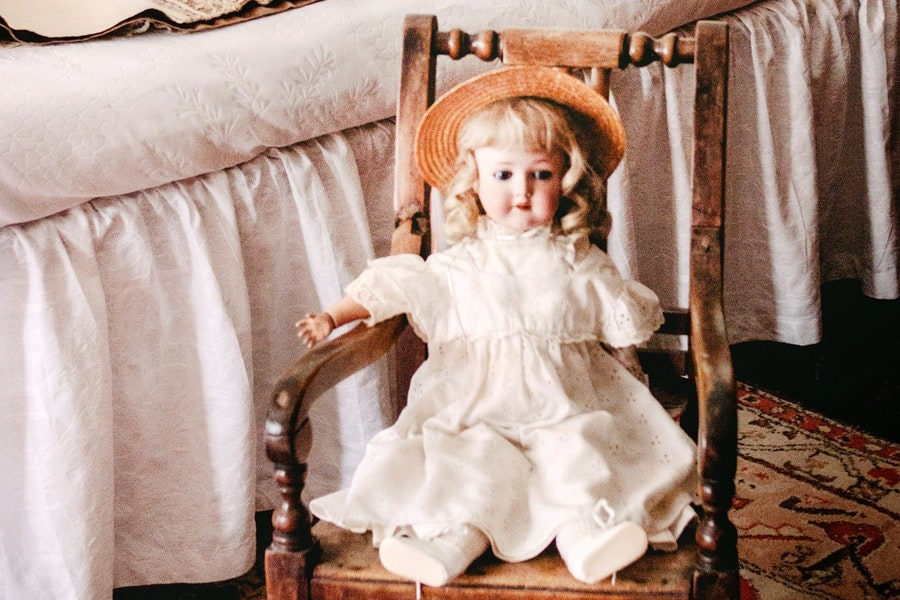 a doll in a sitting position